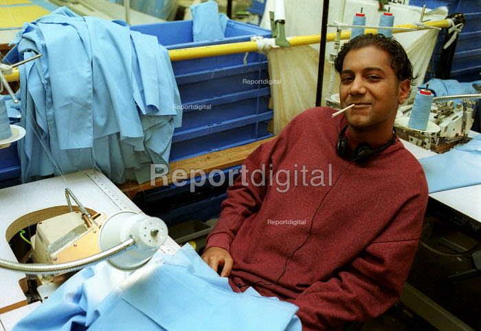 Prisoner takes a fag break from sewing shirts Prison Workshop Pentonville Prison. - Duncan Phillips - 2000-04-15