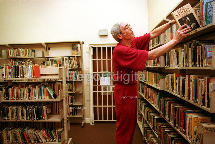 Inmate working in prison Library. Pentonville Prison. - Duncan Phillips - 1999-01-04