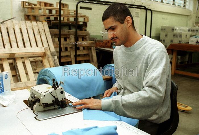 Prisoner sewing cloth, Prison Workshop Pentonville Prison. - Duncan Phillips - 2000-04-15