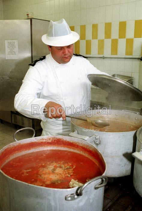 Prison Officer preparing food in prison kitchen. Pentonville Prison. - Duncan Phillips - 1998-05-15