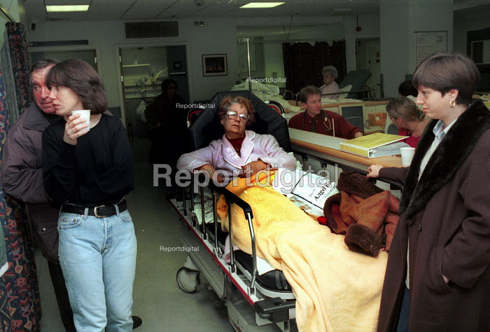 Patient Waiting on trolly in an Accident & Emergency Department of a North London Hospital - Duncan Phillips - 1997-02-16