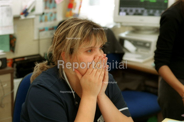 Tired and stressed nurse on a ward at a North London Hospital - Duncan Phillips - 2000-09-16