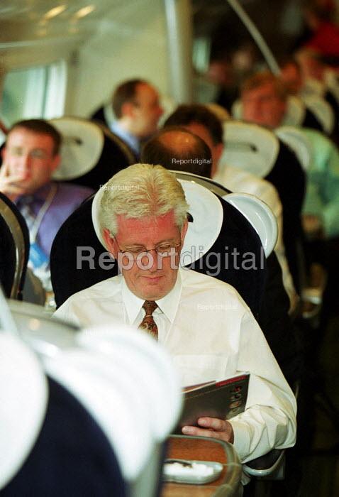 Commuter aboard Virgin Trains Pendolino - Duncan Phillips - 2002-07-23