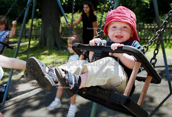 18 month Child on Swing at a playground - Duncan Phillips - 2002-06-16