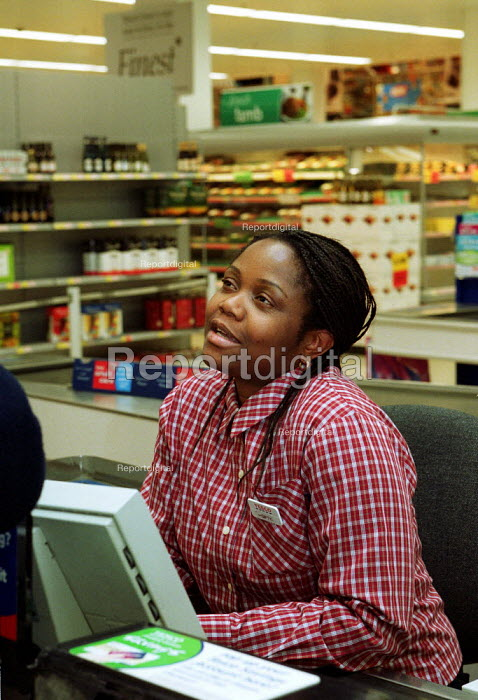 Cashier on the night shift at a 24 hour Tesco supermarket - Duncan Phillips - 2002-10-14