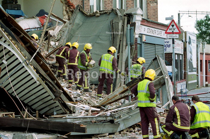 Firefighters hand searching a collapsed building where there was the possibility of trapped building workers. North London - Duncan Phillips - 2002-06-16