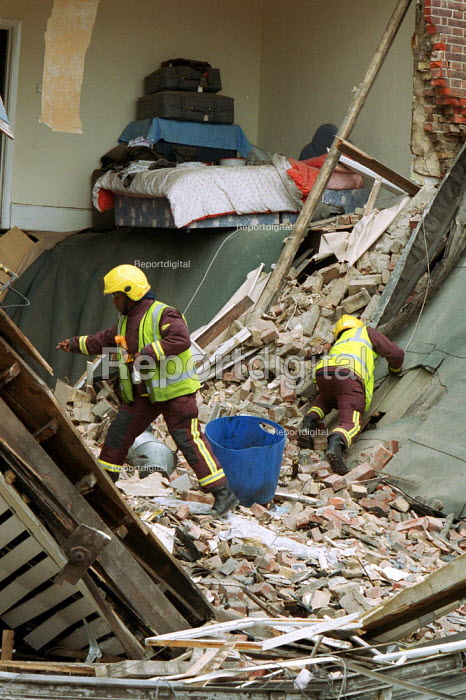 Firefighters using listening equipment to search a collapsed building where there was the possibility of trapped building workers. North London. - Duncan Phillips - 2002-06-16