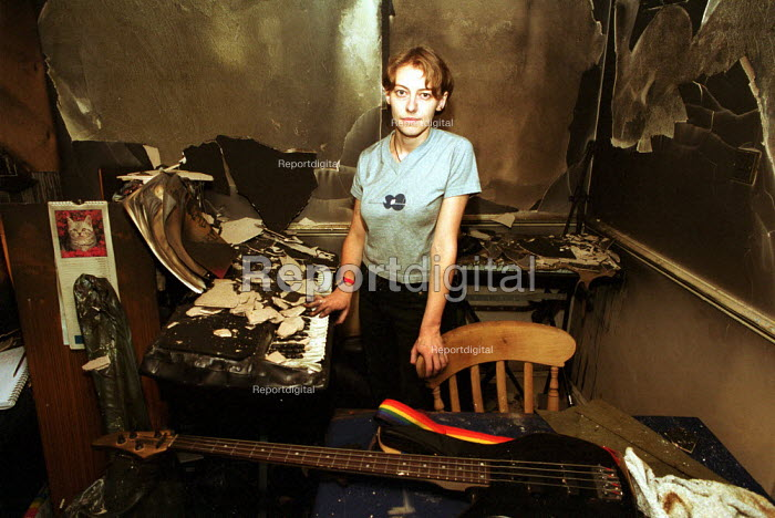 Young Musician standing in her rented basement flat in the aftermath of a domestic house fire. - Duncan Phillips - 2000-11-25