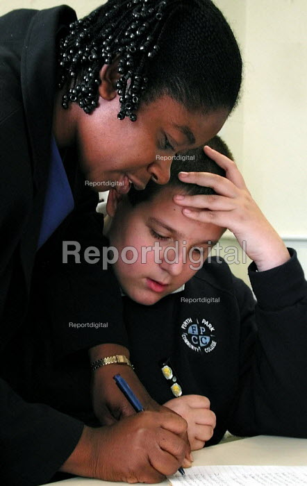 An Australian teacher, enlisted by an English agency in summer 2001, at work with a pupil in an English class at Firth Park Community College, Sheffield due to teacher shortages. - David Bocking - 2001-09-11
