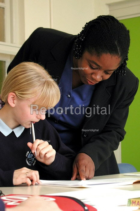 A new teacher for the 2001 year, enlisted from Jamaica, at work in an English class at Firth Park Community College, Sheffield - David Bocking - 2001-09-11