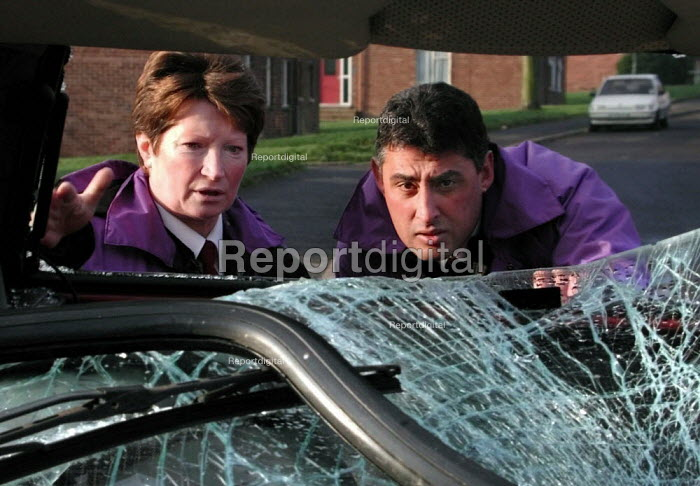 Neighbourhood wardens checking an abandoned car on the Lowedges council estate in Sheffield - David Bocking - 2001-12-10