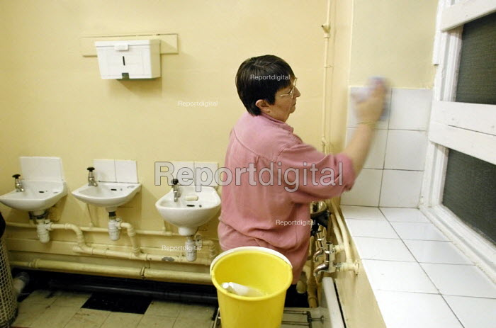 School cleaner at work in a toilet in a Sheffield primary school - David Bocking - 2001-11-29