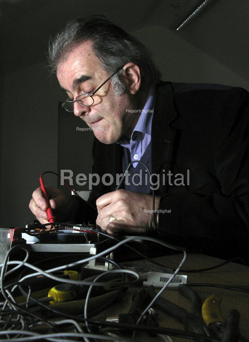 Gordon Ferguson of Repair Sheffield mending a cassette recorder. The voluntary group runs regular Repair Cafes where the public are shown how to mend many household items to help them save money and resources. - David Bocking - 2015-01-08