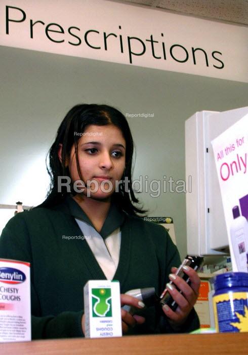 Assistant in a Sheffield pharmacy taking a prescription - David Bocking - 2002-01-11