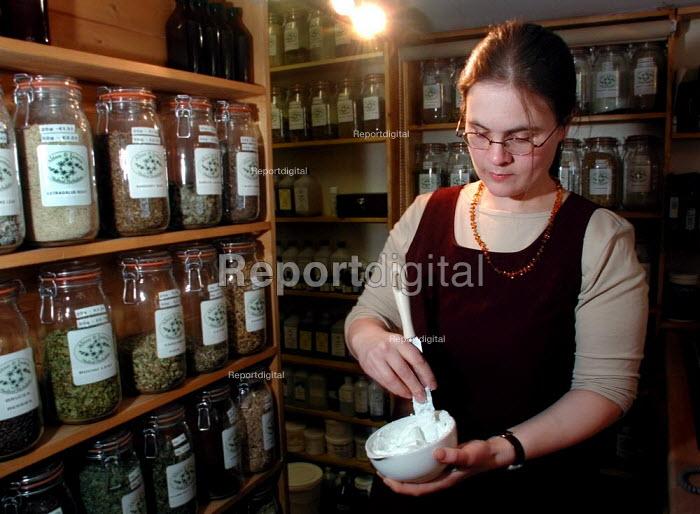 Medical herbalist preparing a tincture - David Bocking - 2002-02-07