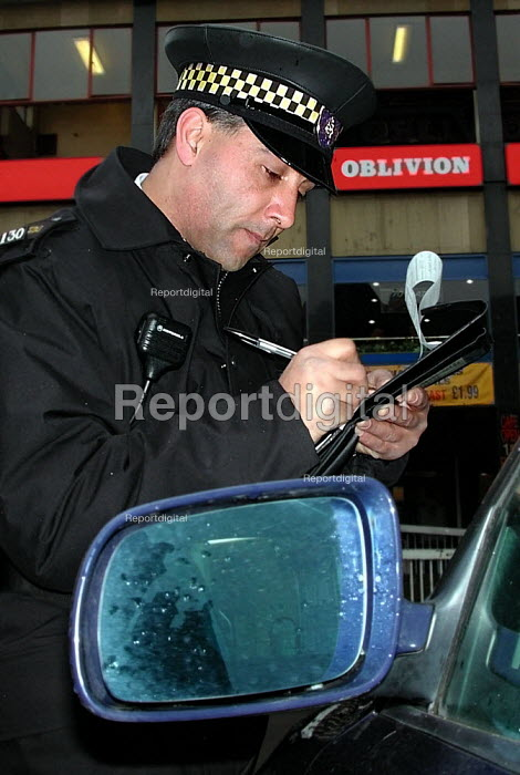 Trainee traffic warden booking an illegally parked car near Sheffield Markets - David Bocking - 2002-03-15