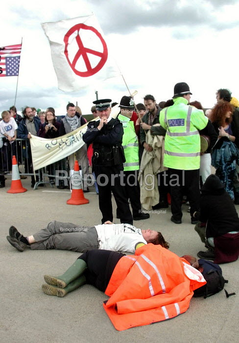 Barbara Maver & Sue Brackenbury (fore) from Faslane Peace Camp with a lock on tube on their arms prior to being arrested at the CND anti Star Wars demonstration at Fylingdales RAF base on 15th June 2002 - David Bocking - 2002-06-15