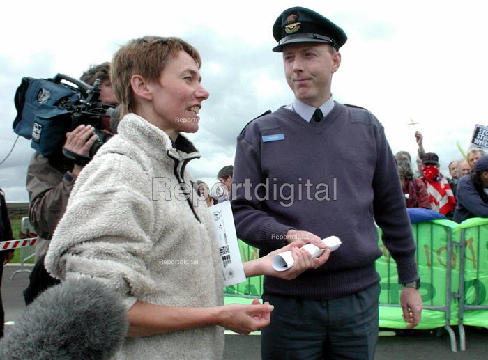 CND Chair Carol Naughton handing in the petition in support of the CND statement on National Missile Defence to RAF Fylingdales Station Commander Wing Commander Chris Knapman at the CND anti Star Wars on 15th June 2002 - David Bocking - 2002-06-15