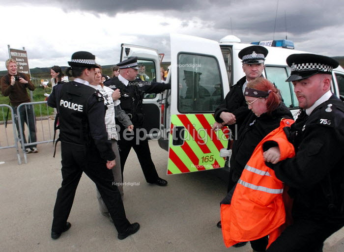 Barbara Maver & Sue Brackenbury (right) from Faslane Peace Camp being arrested for obstruction at the CND anti Star Wars demonstration at Fylingdales RAF base on 15th June 2002 - David Bocking - 2002-06-15