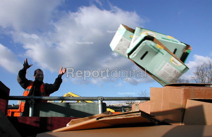 Throwing boxes onto the cardboard recycling skip at an Onyx recycling centre in Sheffield - David Bocking - 2004-02-20