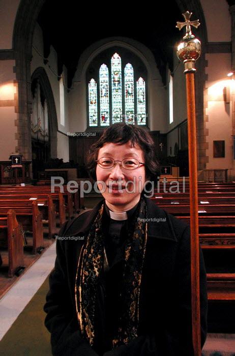Woman vicar at her church in Endcliffe, Sheffield - David Bocking - 2004-03-30