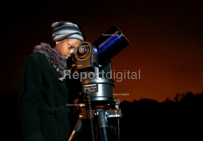 Girl studying the planets at a Sheffield astronomical club - David Bocking - 2005-01-15