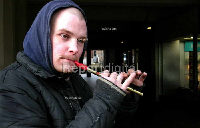 Homeless man busking with a tin whistle in Sheffield city centre - David Bocking - 2005-01-20