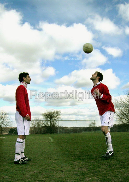 Multiracial amateur football team Sharrow Utd warm up for a Sunday league match in Sheffield: pictured players are Jewish and Muslim - David Bocking - 2005-01-20