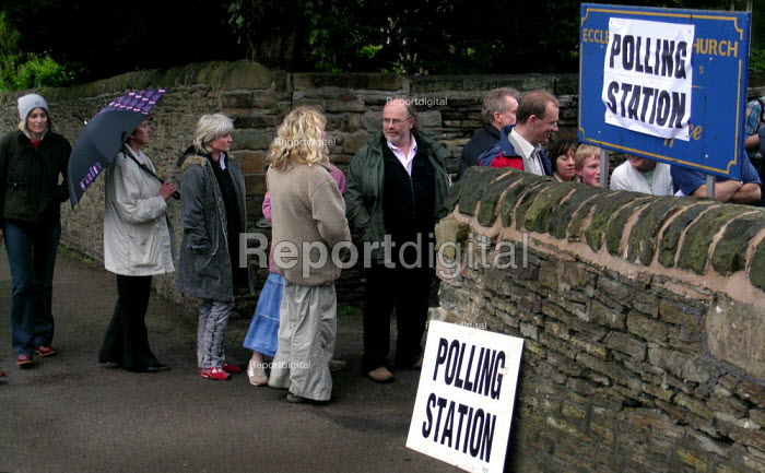 Voters queueing in the drizzle at a polling station in the relatively safe Liberal Democrat seat of Sheffield Hallam - David Bocking - 1994-01-20