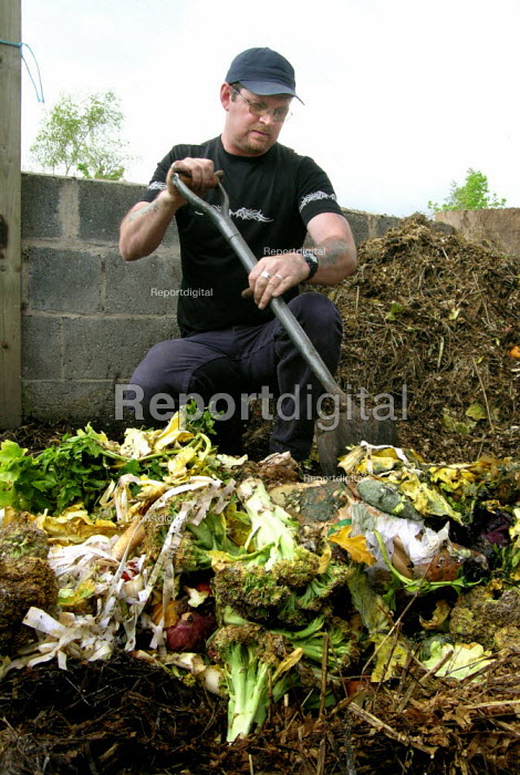 City farm worker turning compost made from organic vegetable waste - David Bocking - 2005-05-03