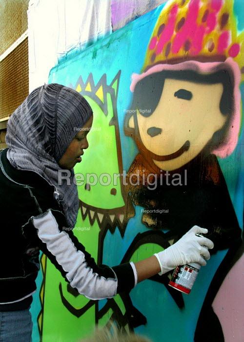 Girl working on a graffiti art workshop at Abbeydale Grange secondary school, Sheffield, during a celebration of the school's new media/arts specialist status. - David Bocking - 2005-06-07