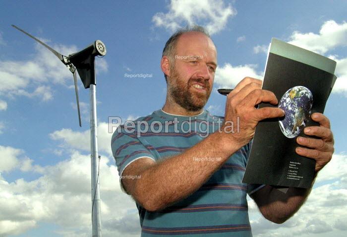 Sheffield farmer monitors the wind turbine used to power his pig and arable farm - David Bocking - 2006-10-02