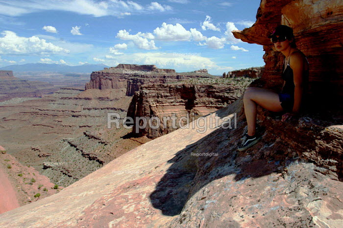 A visitor finding shade from 110 degree heat in Canyonlands National Park. - David Bacon - 2005-08-02