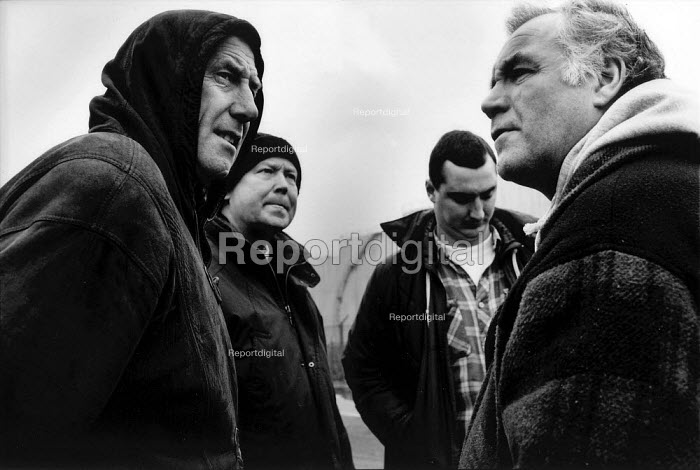 Anger, bitterness and determination on the faces of pickets during the two and a half year long dock dispute during which 400 dockers were sacked for refusing to cross a picket line, during which time the strike remained unofficial and the picket secondary. Liverpool Docks - David Sinclair - 1997-12-12