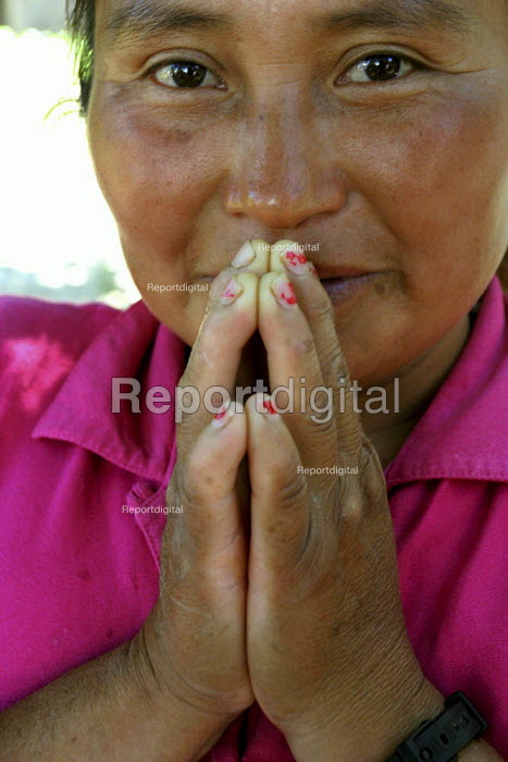 Gloria Merino, a Triqui woman, practices as a Curandera, or traditional doctor, in her community. She holds a bundle of the different herbs she uses in making remedies for various illnesses or problems. California USA - David Bacon - 2006-08-30
