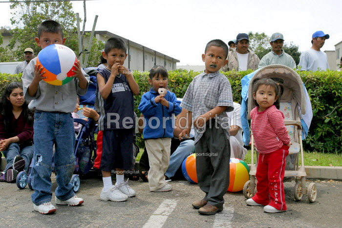 Children in the audience at a fiesta for indigenous Oaxacan immigrant farm workers in Santa Maria organized by the Indigenous Front of Binational Organizations. California USA - David Bacon - 2006-06-25