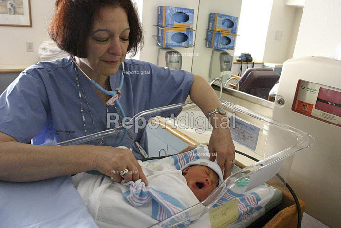 Nurse and newborn infant at Sequoia Hospital, part of Catholic Healthcare West. - David Bacon - 2005-03-07