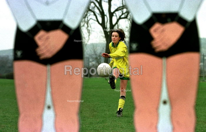 Girls football team member practising shooting against a wall of cut out players at a Sheffield sports club - David Bocking - 1998-03-21
