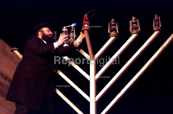 Sheffield's Orthodox Rabbi lighting the Menorah in the civic Channukah ceremony in Sheffield city centre - David Bocking - 1998-12-20