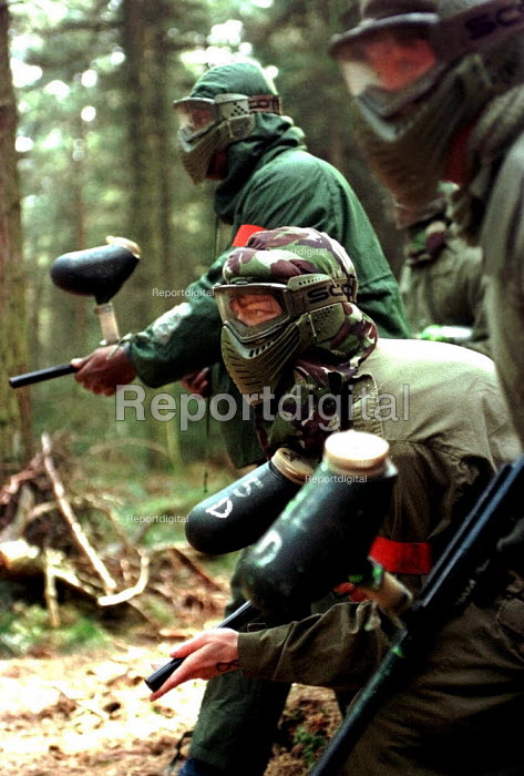 Group of doctors and other medical professionals on a paintballing team building exercise - David Bocking - 1999-03-21
