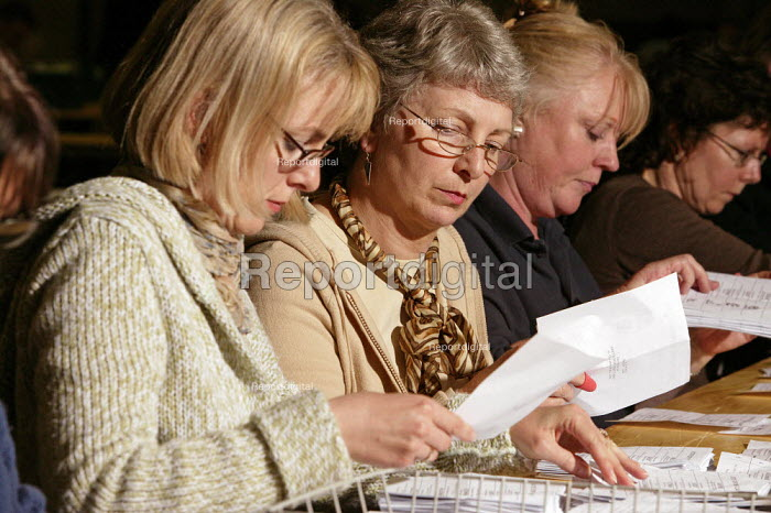 Local people from the Dorchester area are seen working as counters, also known as tellers, counting parliamentary election voting papers in the early hours of Friday morning after the Thursday 5 May 2005 General Election. - David Mansell - 2005-05-06