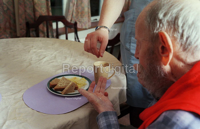 Old man seen being given his daily tablets by a care nurse at a private nursing home at the Surrey Heights,Wormley, Surrey. - David Mansell - 2002-03-03