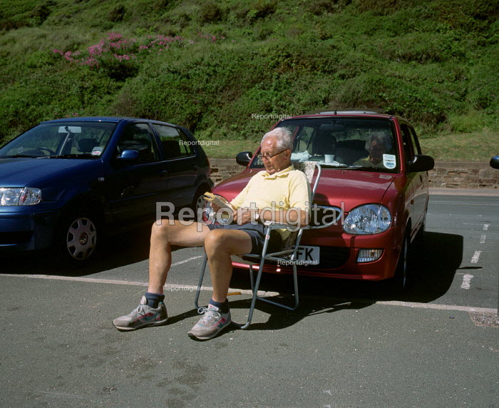 Devon Coastal Walk. Exmouth. pensioner seen relaxing sitting in front of his car. - David Mansell - 2002-07-21