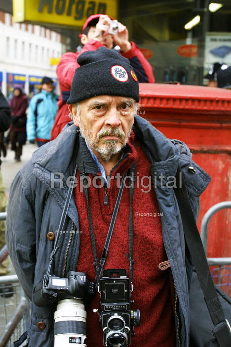 David Bailey 65 year old, famous 1960's fashion photographer seen working during the Anti Iraq War Demonstration in London on Saturday 15 February 2003. - David Mansell - 2003-02-15
