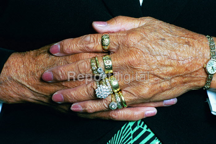 Old ladie's hand with her left hand covered with gold rings on every finger. - David Mansell - 2003-07-01