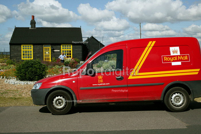 Royal Mail postman delivers letters to Derek Jarman 's house at Dungeness, Kent, the country's largest and oldest shingle beach dating back over 800 years. - David Mansell - 2004-05-03