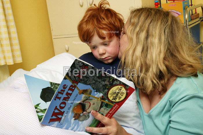 Bedtime reading. Five year old Jamie is seen reading to his mother before he goes to sleep. - David Mansell - 2004-06-22