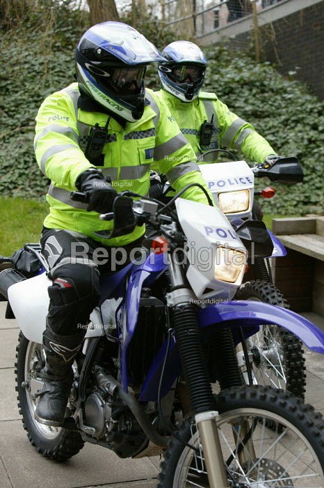 Birmingham University - West Midlands Police Officers using off road motor cycles to patrol the university campus and surrounding areas to fight and beat crime. - David Mansell - 2005-03-15