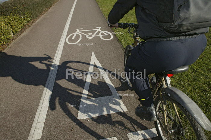 A woman cyclist using a cycle route in Aylesbury, Buckinghamshire. 
