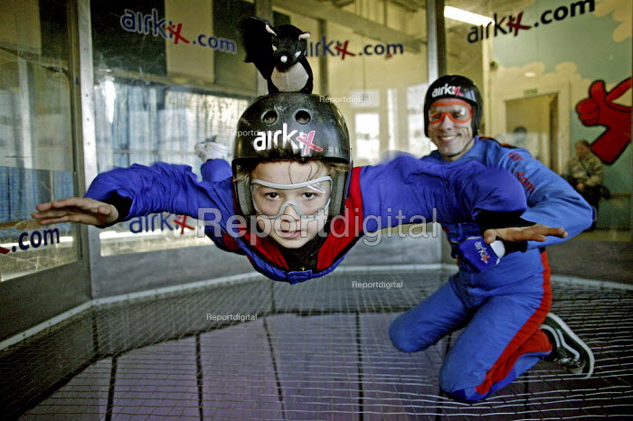 Indoor Skydiving at the Airkix Windtunnel Xscape Centre, Milton Keynes. Joe Flanagan 7 year old is seen flying unaided, with his instructor close at hand. - David Mansell - 2008-04-11